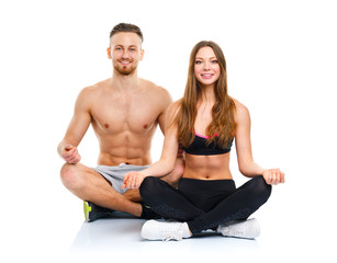Athletic couple - man and woman practicing yoga