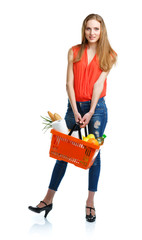Happy woman holding a basket full of healthy food. Shopping