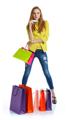Happy lovely woman with shopping bags and credit card over white