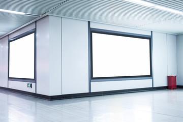 Blank billboard on the wall in corridor