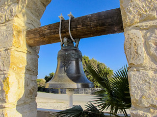 brass bell in the courtyard of the church, cyprus