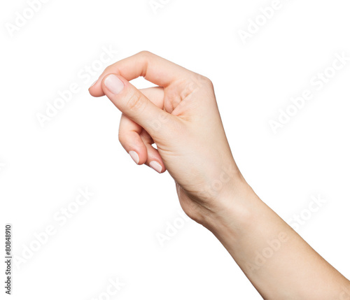 Leinwanddruck Bild Woman's hand holding something, isolated on white