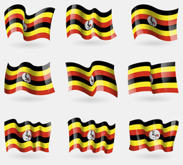 Set of Uganda flags in the air. Vector