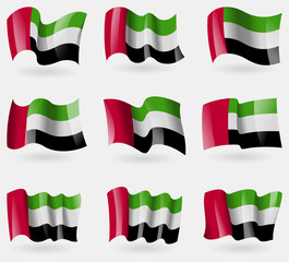 Set of United Arab Emirates flags in the air. Vector