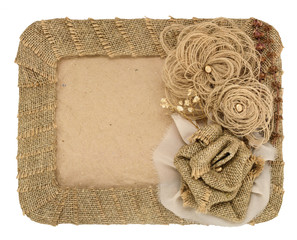 The frame is made of burlap and a rose isolated