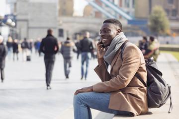 Black man talking on mobile phone in London