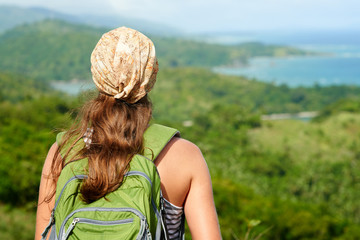 Young traveling woman with backpack. focus on traveller