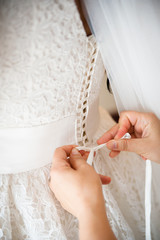 bride getting dressed on her best day ever