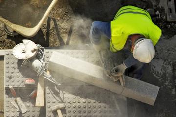 street workman repairing sidewalks and pipelines