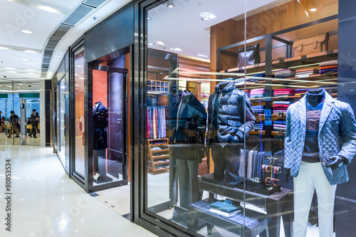 Leinwanddruck Bild fashion shop display window and clothes.