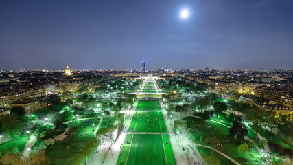 Champs de Mars from the Eiffel tower at night with rising Moon