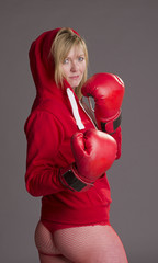 Woman fighting fit and wearing red boxing gloves