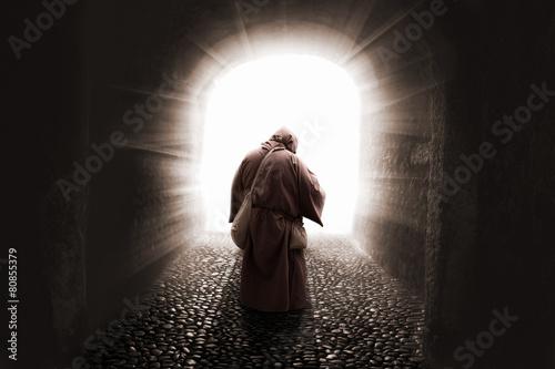 Leinwandbild Motiv blissed Friar with faith illuminated by god