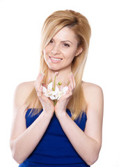 the blonde woman with long hair holding a flower orchid