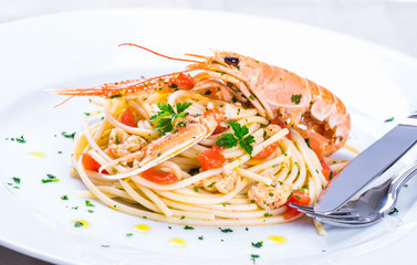Plate with seafood spaghetti pasta.Restaurant menu dish.
