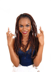 African woman crossing finger.