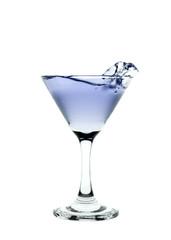 Blue liquid splashing in a martini glass isolated on white backg