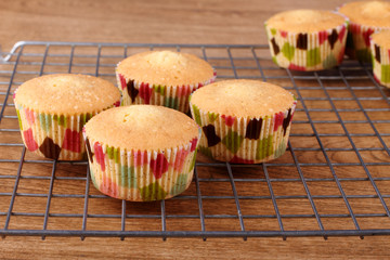 Freshly baked muffins served on cooling rack