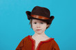 little girl  wearing a cowboy hat