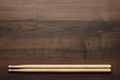 Leinwanddruck Bild - wooden drumsticks on wooden table