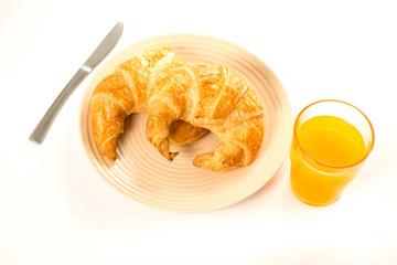 Croissant and orange juice. on white isolated background