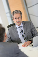 Mature businessman meeting with job applicant