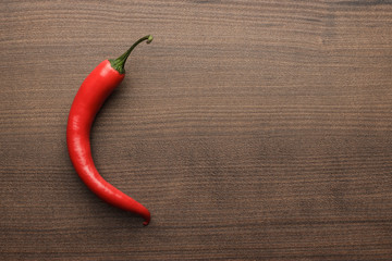 red hot chilli pepper on wooden table