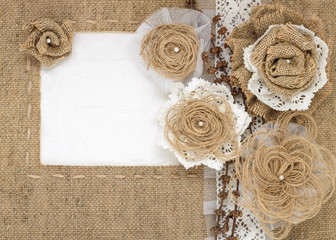 The framework is made of burlap and rustic roses