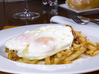 Dish of fried eggs on a potato chip
