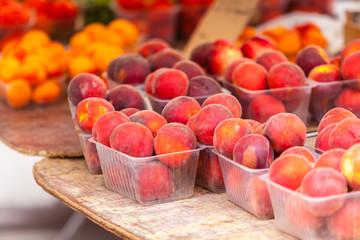 Ripe fresh peaches in a farmers market