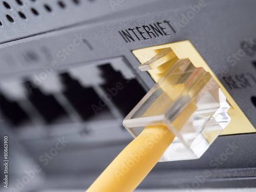 Network yellow cable connected to a router or modem - 80863900