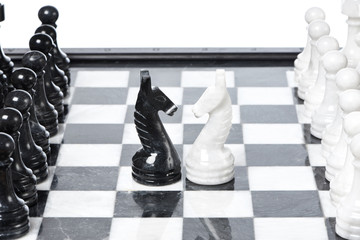 Chessmen face to face on chessboard