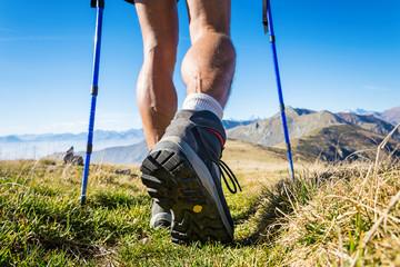 Trekker walking on the mountains. Italian Alps.