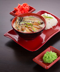 Tradisional japanese soup with eel fish in coconut milk