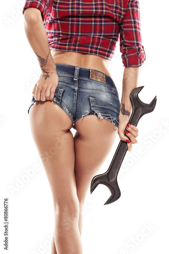 Nice sexy woman mechanic showing  bum buttock  and holding wrenc