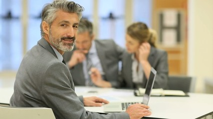 Portrait of businessman attending seminar