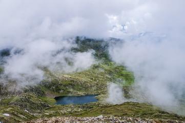beautiful mountain lake in clouds