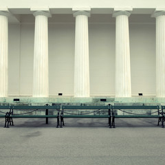 Row of columns and empty benches, Vienna