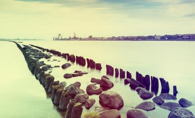Old broken pier in river of Daugava in Riga, Latvia