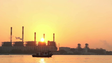 Electric power plant at sunrise