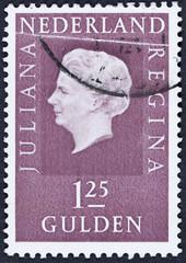 Stamp printed in Netherlands shows portrait of Queen Juliana