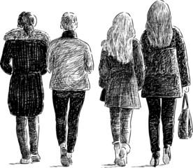 girls walks on city street