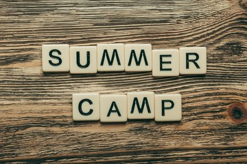 Camp. Summer camp text  on a wooden background