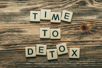 Detoxing. Time To Detox text on a wooden cubes on a wooden
