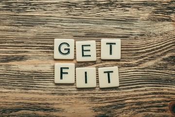 Fit. Get Fit text on a wooden background