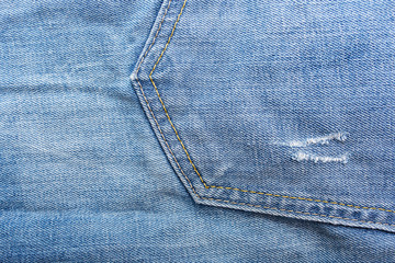 Fragment of material jeans, denim texture background. Pocket..