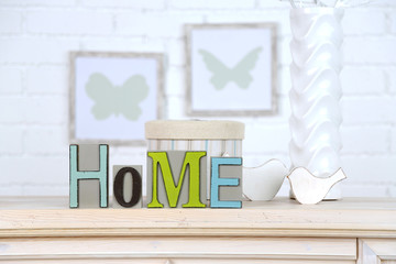 Home in colorful letters, in light white interior,