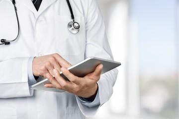 Doctor. Doctor using a digital tablet