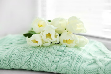 White beautiful tulips in light interior