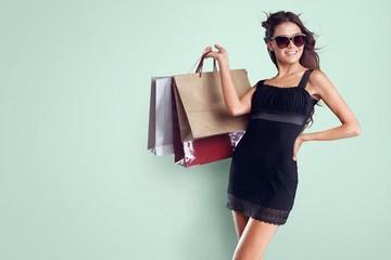 Handbag. Beautiful young woman posing in sunglasses, leather
